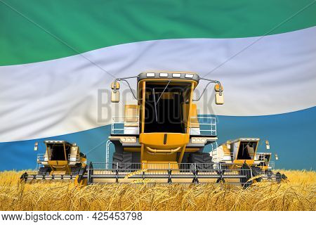 Industrial 3d Illustration Of 4 Orange Combine Harvesters On Wheat Field With Flag Background, Sierr