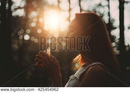 Red-haired Beautiful Woman Holding Magic Crystal. Meditation Spiritual