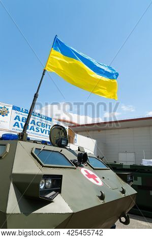 Medical Armored Personnel Carrier. Flag Of Ukraine On The Armor Of Medical Armored Vehicles At The I