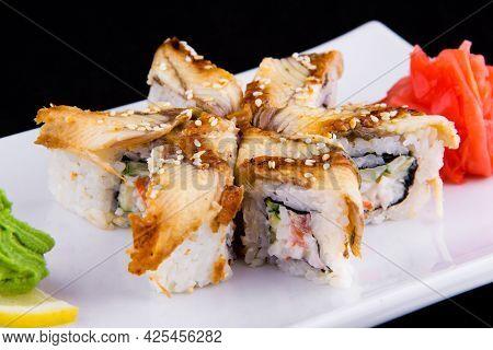 Unagi Kani - Sushi Roll With Crab, Eel, Tomato, Cucumber, Mayonnaise, Sesame Close Up.