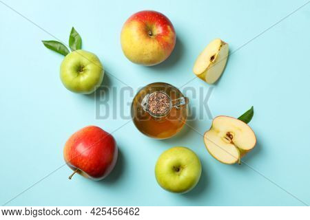 Homemade Apple Vinegar And Ingredients On Blue Background
