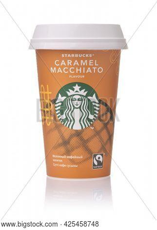 Samara, Russia - June 2021. Paper cup of Starbucks Caramel Macchiato cold coffee  isolated on white