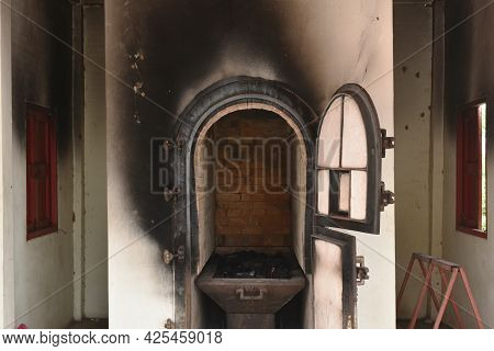 Door For Push Coffin To Burning In Cremation Furnace Building