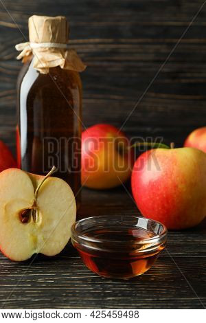 Homemade Apple Vinegar And Ingredients On Wooden Background