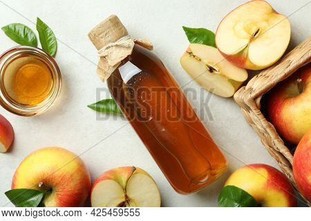 Homemade Apple Vinegar And Ingredients On White Textured Table