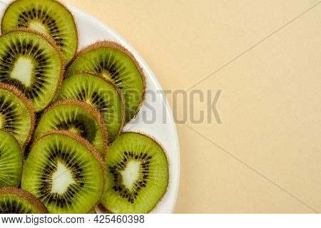 Peeled Kiwi On A Plate. Kiwi Peeled And Kiwi In The Peel Closeup.