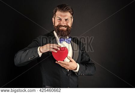 In Love. Happy Handsome Man Making Proposal. Romantic Gift. Tuxedo Man With Heart.