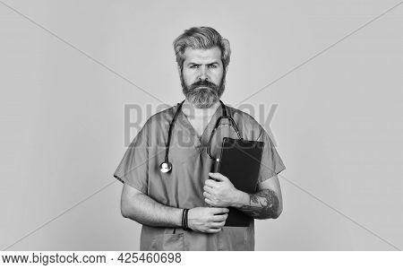 Therapist Writing Prescription. Medical Nurse Folder With Documents. Going To Have Look At Patient.