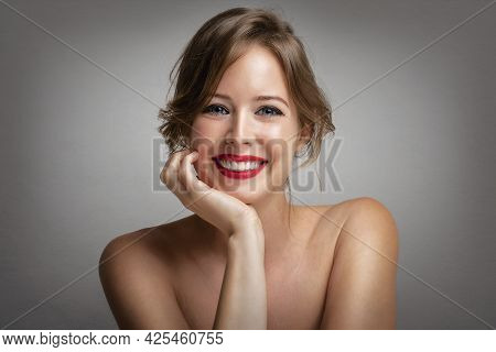 Close-up Beauty Portrait Of Attractive Woman Wearing Red Lipstick