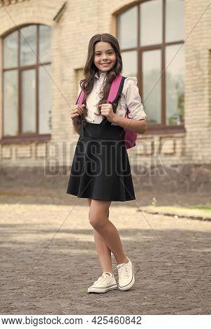 Happy Kid In Uniform Back To School Carrying Backpack In Schoolyard, Schooling