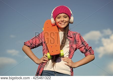 Active Lifestyle. Active Girl Skater Hold Penny Board Sunny Sky. Action Sport. Recreational Activity