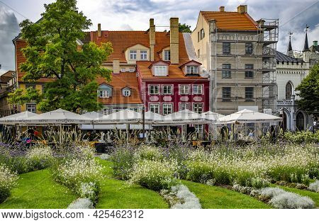 Latvia, Riga, May, 2021 - Ancient Gothic Architecture With Beautiful Landscaping In The Livu Square