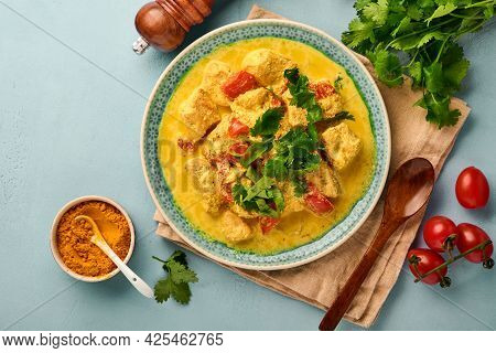 Chicken Tikka Masala. Traditional Of Indian Cuisine Curry And Ingredients On Dark Background. Curry,