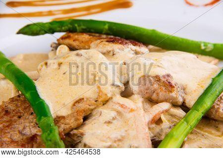Pork Medallions With Asparagus: Pork Tenderloin, Asparagus, Mushrooms, Leeks, Onions, Carrots And De