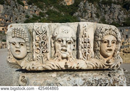 Ruins of ancient city of Myra in Demre, Turkey. Theatrical mask relief of ancient town of Myra in Lycia region