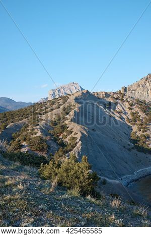 View Of The Mountain Range From Above, The Mountain Range Divides The Photo In Half, The Landscape A