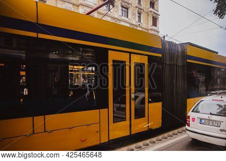 Budapest, Hungary - May 2018: Yellow Tram In Budapest On The Side Of The Pests In Budapest. A Lot Of