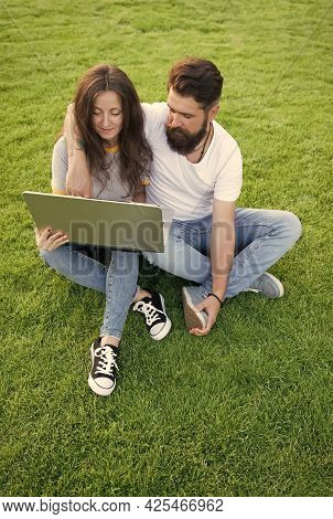 Laptop With Internet Connection. Bearded Man And Sexy Girl Use Laptop Outdoors. Laptop Computer. Not