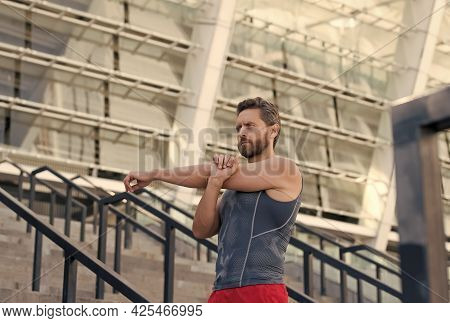 Man Stretching. Keeping Those Muscles Flexible. Training On Fresh Air. Warming Up His Muscles. Stret