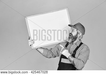 Person Presenting At A Flip-chart. Copy Space. Businessman. Male Construction Worker. Man With Prese