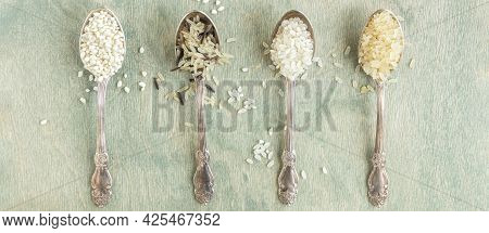 Top View On Different Types Of Rice In Spoons With Copy Space. Wild Rice, Sushi Rice, Shredded And S