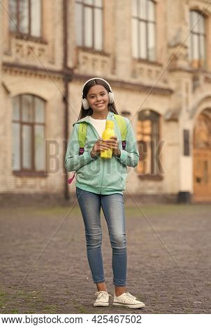 Health Hydration For Child With Water Bottle Listening Music In Headphones And Carry School Backpack
