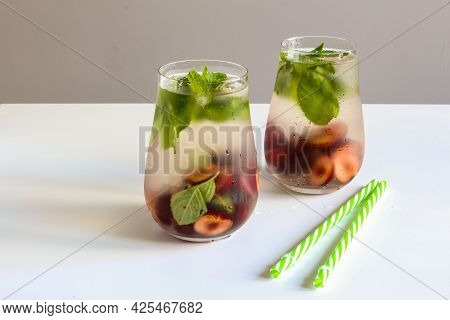 Cold Drinks In Small Bottles. Cherries And Mint Lemonade. Mojito Coctail. Summer Iced Refreshment Dr