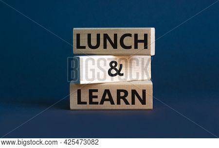 Lunch And Learn Symbol. Wooden Blocks With Concept Words Lunch And Learn. Beautiful Grey Background,