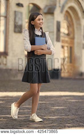 Uniform Me. Happy Child With Book Wear Uniform Outdoors. Formal Fashion. Dress Code. School Educatio