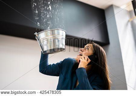 Ceiling Damage Water Leak In House. Calling Plumber