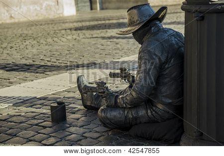 Gunslinger From The Future Begging