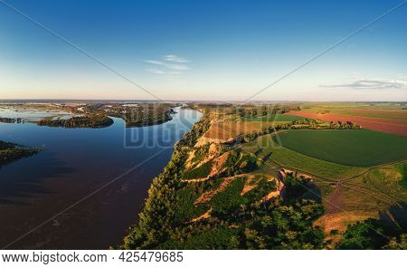Aerial drone view of river landscape in sunny summer evening. Top view of siberian Ob river from high attitude in summer sunset. Panorama, bird's eye view