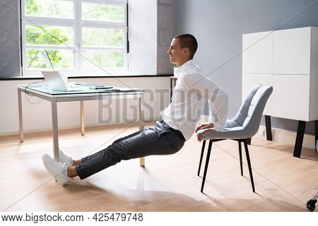 Chair Triceps Dip In Office. Workout Exercise At Desk