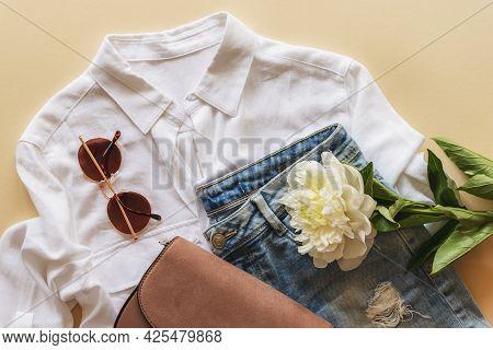Feminine Summer Fashion Flat Lay With Blouse, Handbag, Sunglasses And White Peony Flower On Beige Ba