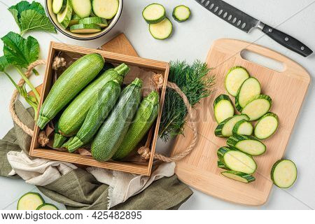 Slicing Zucchini On A Cutting Board. Ripe Zucchini On A Gray Background. Top View, Horizontal.