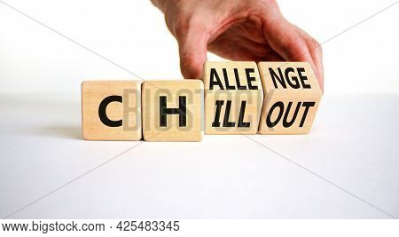 Chillout Or Challenge Symbol. Businessman Turns The Wooden Cube And Changes The Word Chillout To Cha