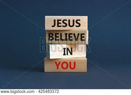 Jesus Believe In You Symbol. Concept Words 'jesus Believe In You' On Wooden Blocks On A Beautiful Gr