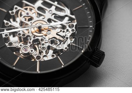 Skeleton Wrist Watch With Black Clock Face, Macro Photo. It Is A Mechanical Watch Type In Which All