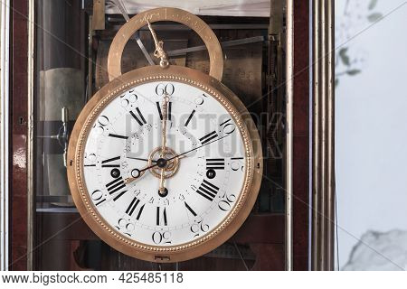 Vintage Grandfather Clock With White Clock Face. Close Up Photo