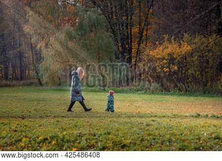 Family Walking In The Park In Autumn, Autumn Landscape, Baby Running Away From Mom, Parental Leave