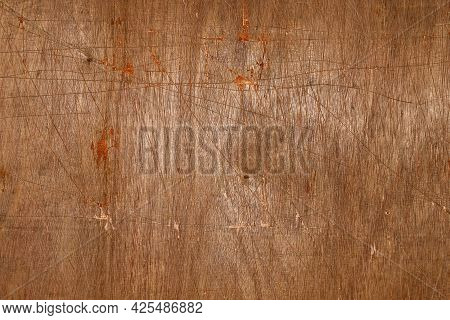 Brown Background. Old Plywood Texture With Scratches And Dents.