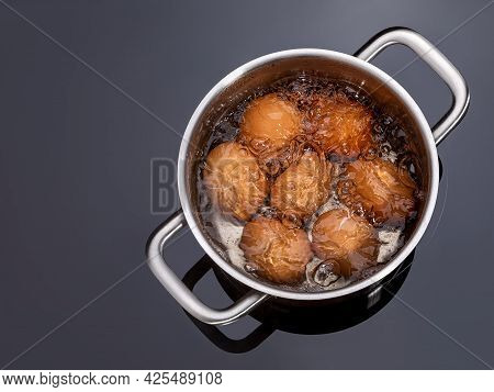 Chicken Eggs Are Boiled In A Saucepan On A Glass Ceramic Induction Hob. Cooking Hard Boiled Eggs In