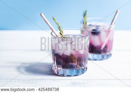 Chilled Water With Ice And Blueberries In A Glass With A Cocktail Tube. Summer Refreshing Cocktails