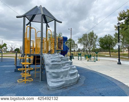 Children Playground Activities In Public Park. Slide, Swing On Modern Playground. Urban Neighborhood