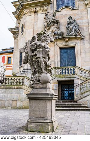 Kuks, Czech Republic - May 15, 2021. Statue Of Religion - Statue Of An Angel With Symbols Of The Old
