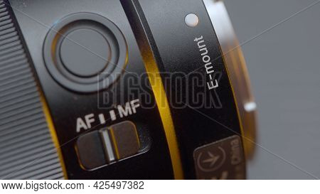 Close-up Of Ring With Settings On Lens. Action. Focal Length And Other Settings On Professional Lens