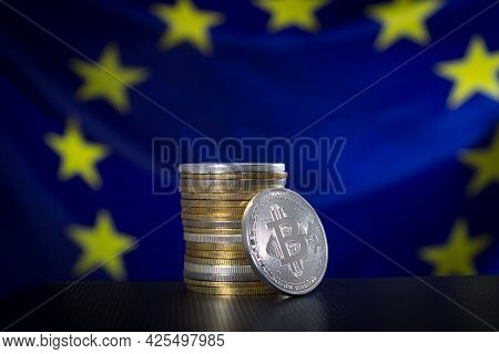 Stack Of Bitcoins Over Eu Flag. Focus On Bitcons.