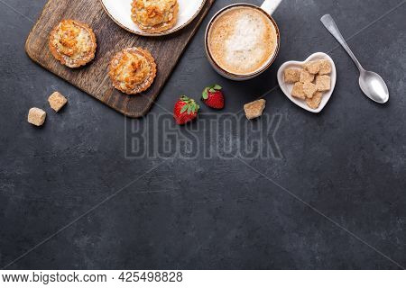 Coffee, Cakes, Strawberries On A Wooden Cutting Board. Dark Stone Table. Tasty Breakfast. Top View.