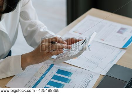 Close Up Busy Woman Using Calculator, Renter Checking Bills, Planning Budget, Sitting At Desk With F