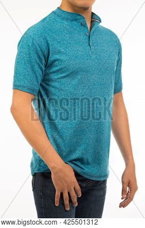 Torso Man In A Blue Cerulean Shirt With Short Sleeve And Band Collar Expose Arm And Hand In Studio L